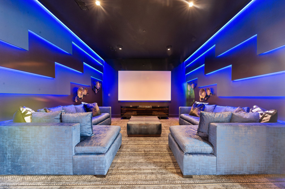 Example of a trendy carpeted and gray floor home theater design in Dallas with gray walls and a projector screen