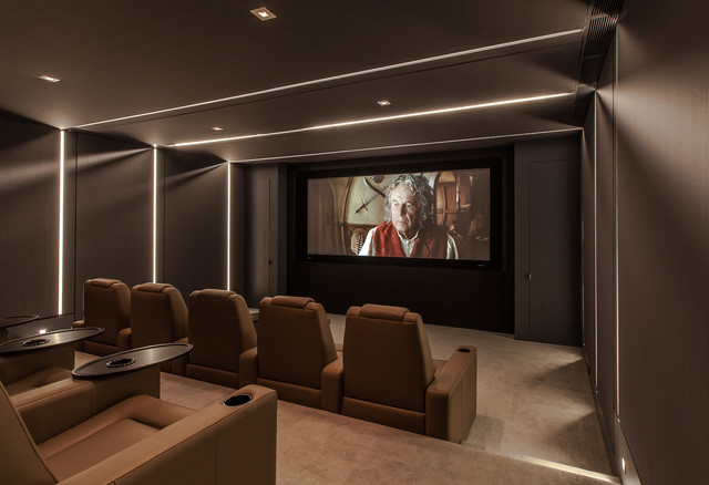 Inspiration for a mid-sized contemporary enclosed carpeted and brown floor home theater remodel in Los Angeles with brown walls and a projector screen
