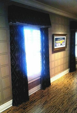Transitional home theater photo in Indianapolis with beige walls and a media wall