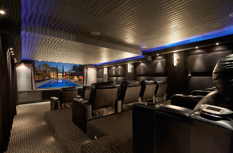 Home theater - contemporary enclosed carpeted home theater idea in Los Angeles with black walls and a media wall