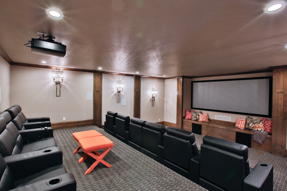 Example of a large transitional enclosed carpeted home theater design in Salt Lake City with beige walls and a projector screen