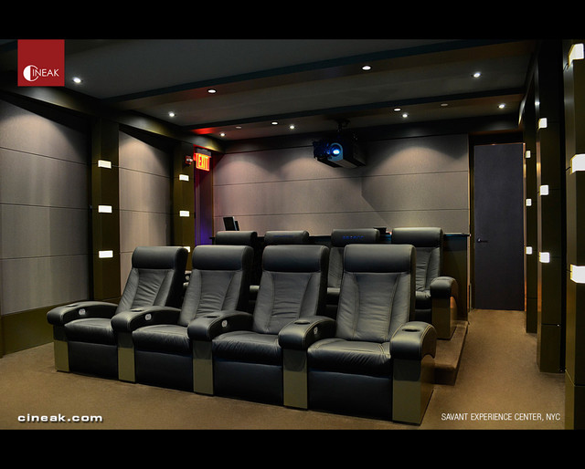 Savant experience center with cineak seats modern for Modern theater room