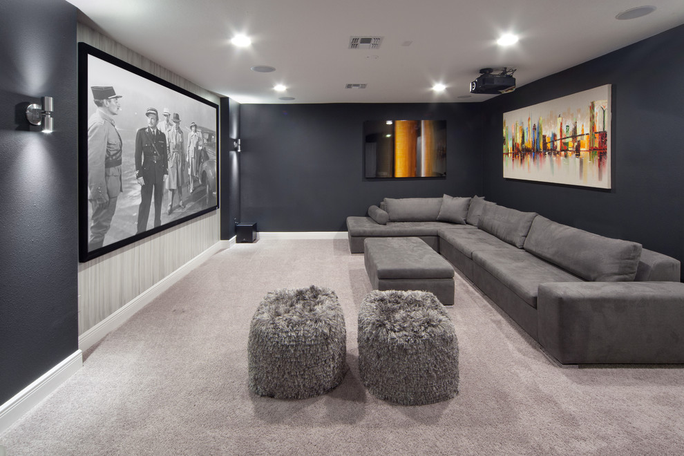 Mid-sized transitional enclosed carpeted and gray floor home theater photo in Orlando with black walls and a projector screen