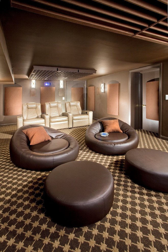 Mid-sized minimalist enclosed carpeted and multicolored floor home theater photo in Newark with brown walls and a wall-mounted tv