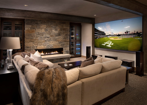 sectional sofa in a media room with a fireplace