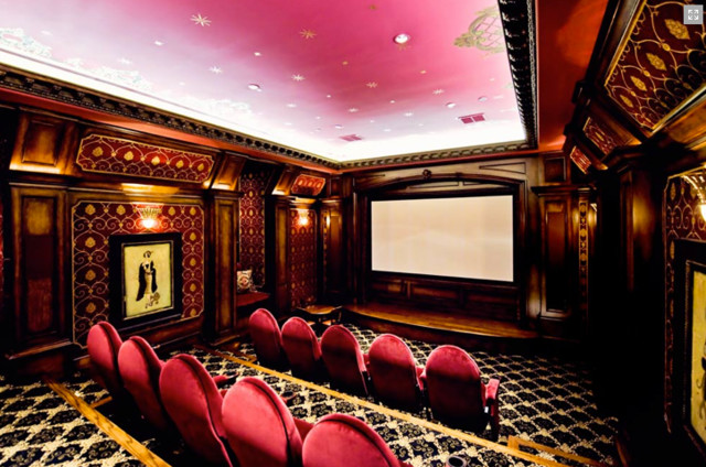 Example of a large enclosed carpeted home theater design in Dallas with pink walls and a projector screen