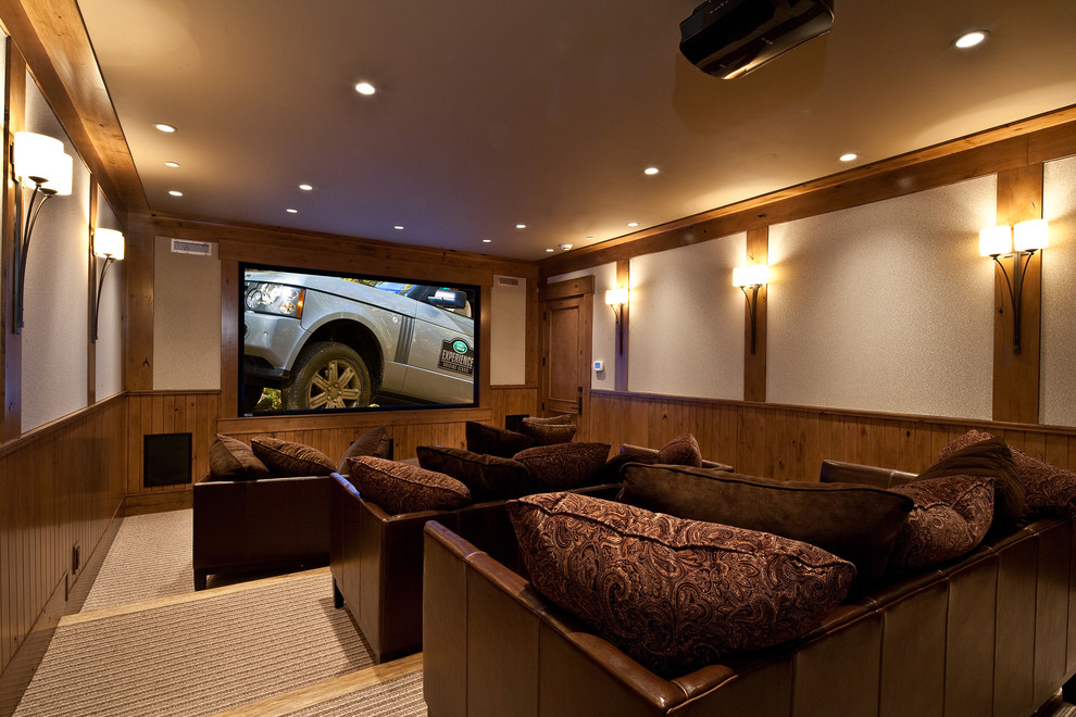 Inspiration for a timeless beige floor home theater remodel in Salt Lake City with a projector screen