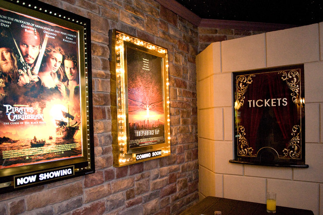 theater room entry with light up movie poster cases and
