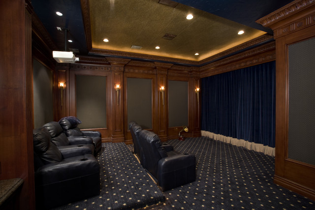 theater with motorized drapery over screen mediterranean