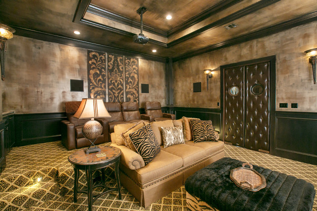 mediterranean media room by Terry M. Elston, Builder