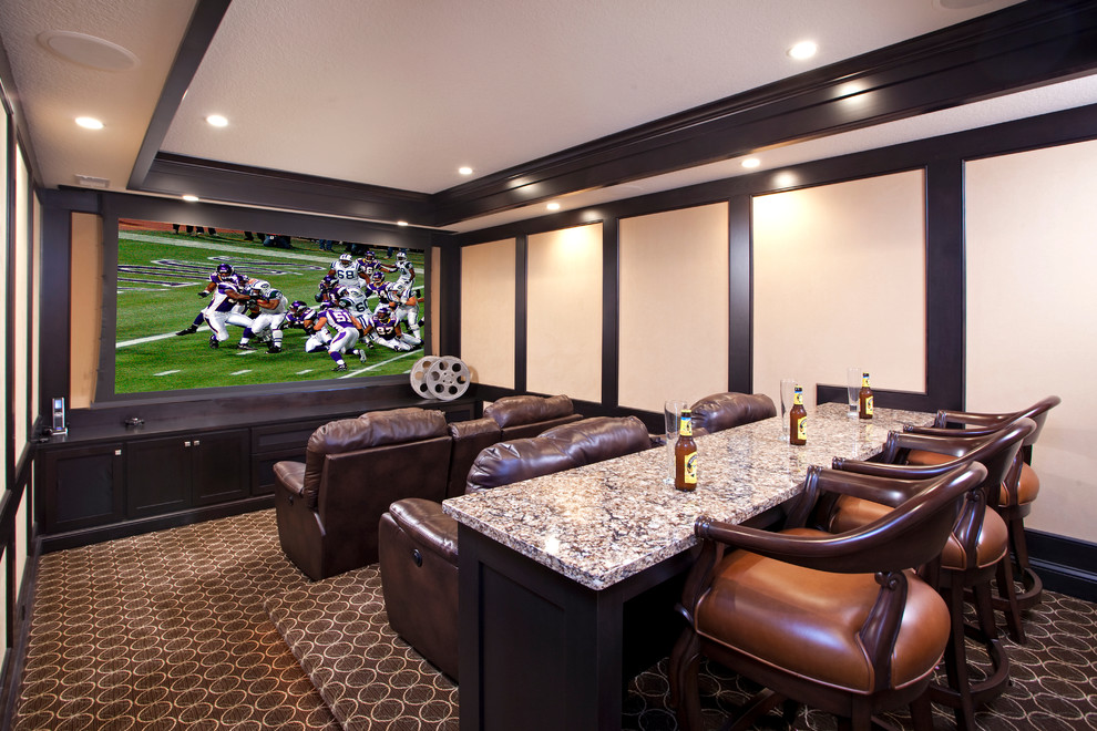Example of a classic enclosed carpeted home theater design in Minneapolis with a projector screen