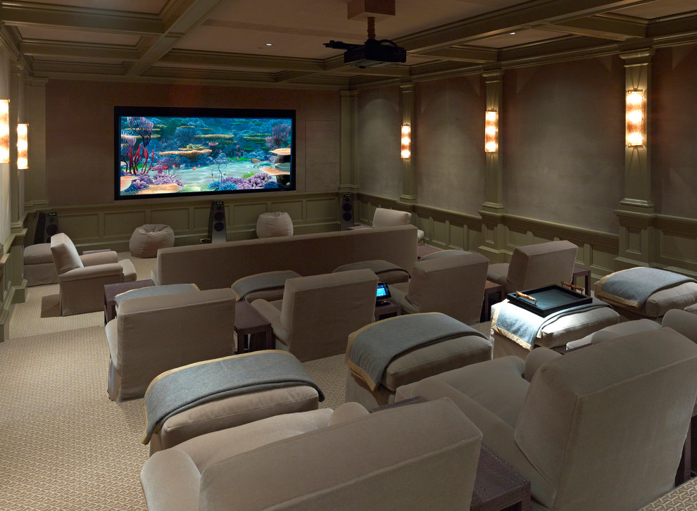 Home theater - large traditional enclosed carpeted and beige floor home theater idea in Dallas with a projector screen and gray walls
