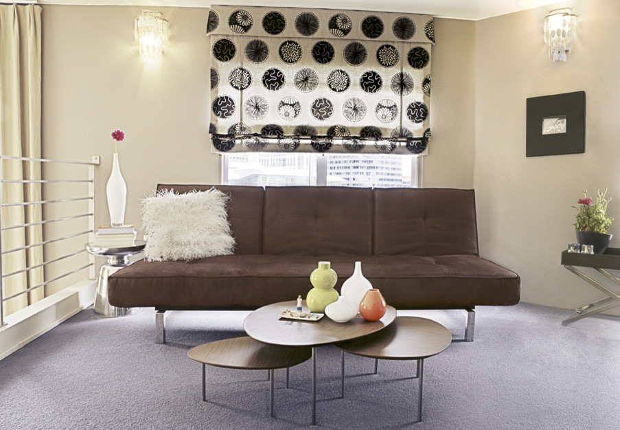 Example of a small trendy enclosed carpeted home theater design in San Francisco with beige walls and a wall-mounted tv