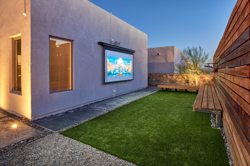 Home theater - small contemporary open concept concrete floor and green floor home theater idea in Austin with white walls and a projector screen