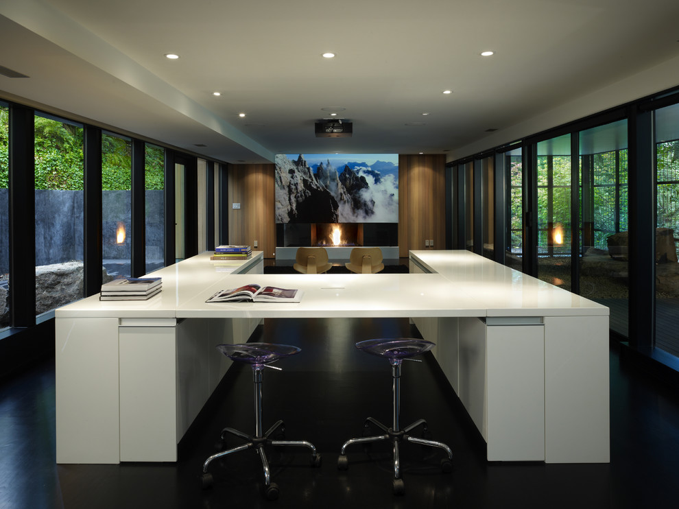 Design ideas for a mid-sized modern open concept home theatre in Seattle with a projector screen, white walls, dark hardwood floors and black floor.
