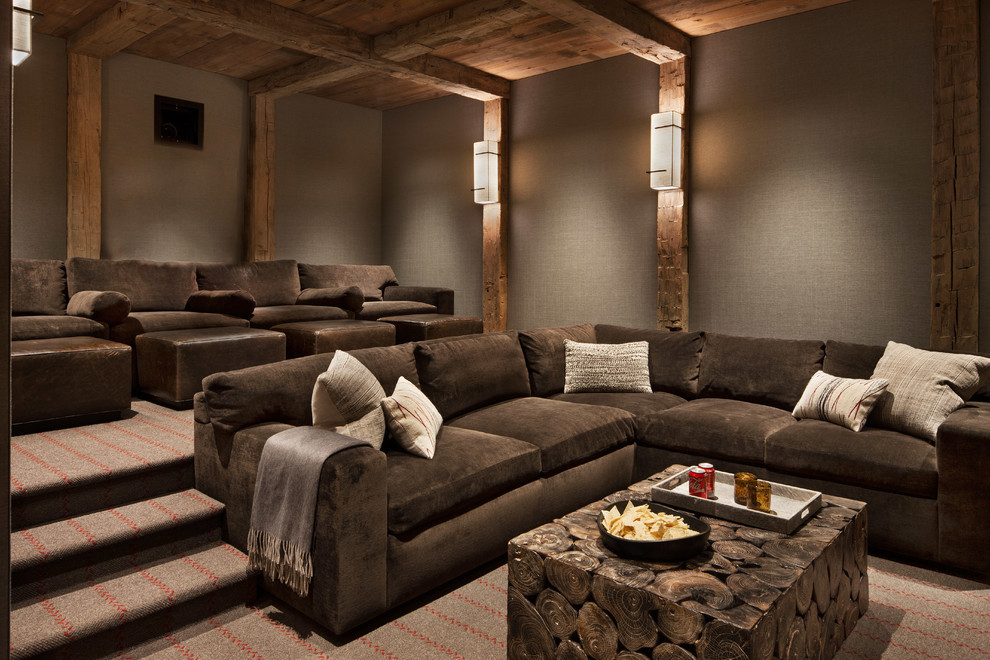 Inspiration for a large rustic enclosed carpeted and gray floor home theater remodel in Other with gray walls