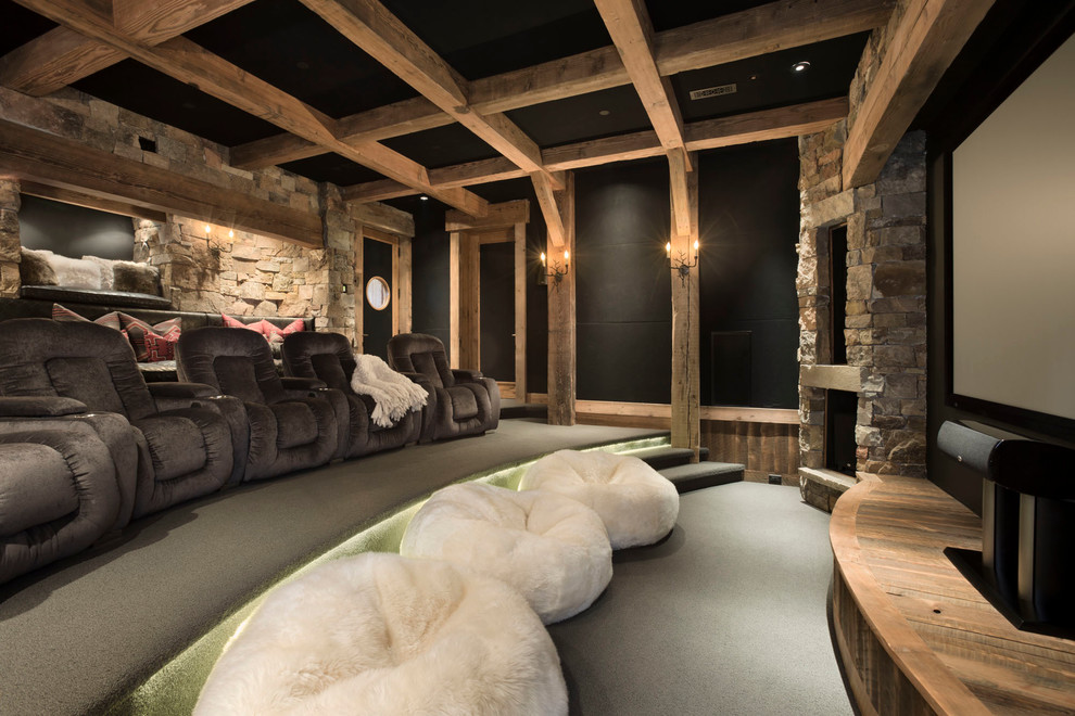 Example of a mountain style carpeted home theater design in Other with black walls