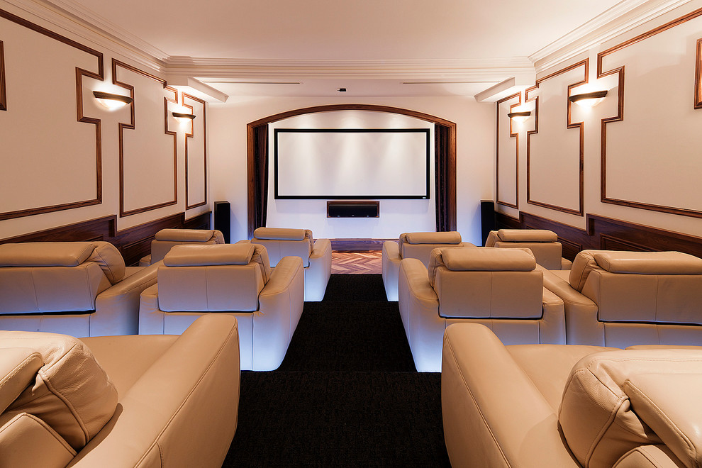 Example of a large transitional enclosed carpeted and black floor home theater design in Melbourne with white walls and a projector screen