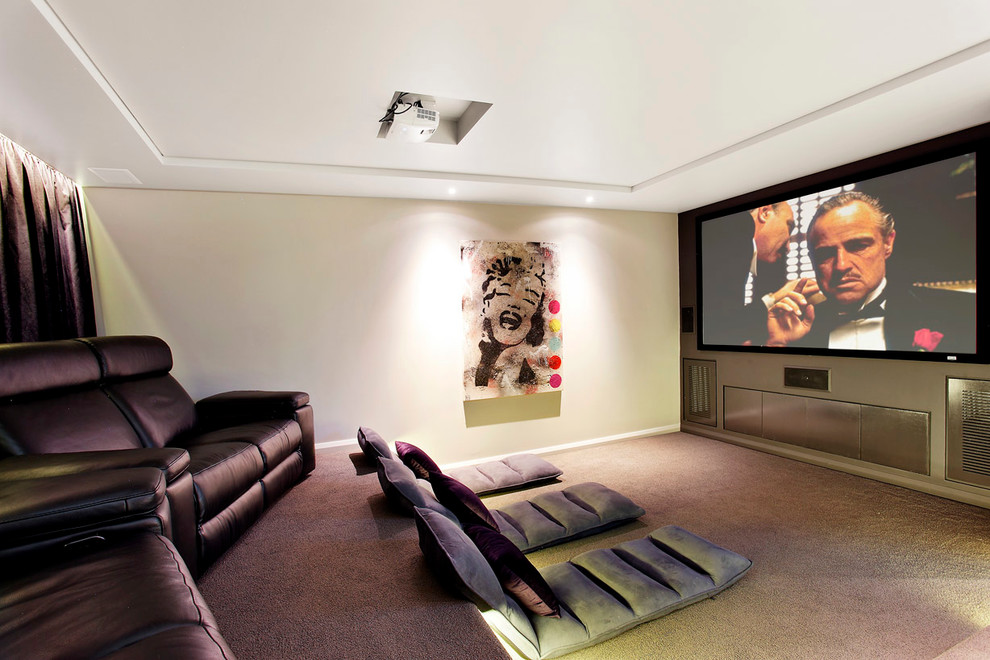 Example of a trendy enclosed carpeted home theater design in Sydney with gray walls and a projector screen