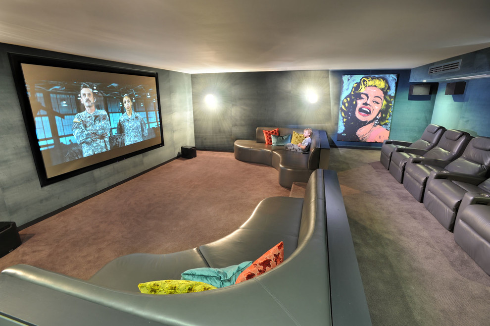 Inspiration for a large contemporary enclosed home theatre in Melbourne with grey walls, carpet, a projector screen and grey floor.