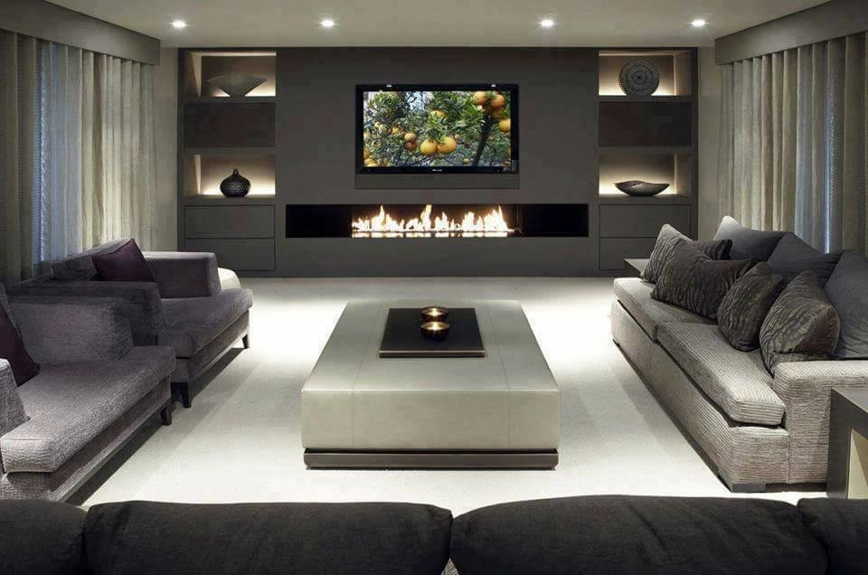Home theater - large modern home theater idea in Sydney with gray walls and a wall-mounted tv