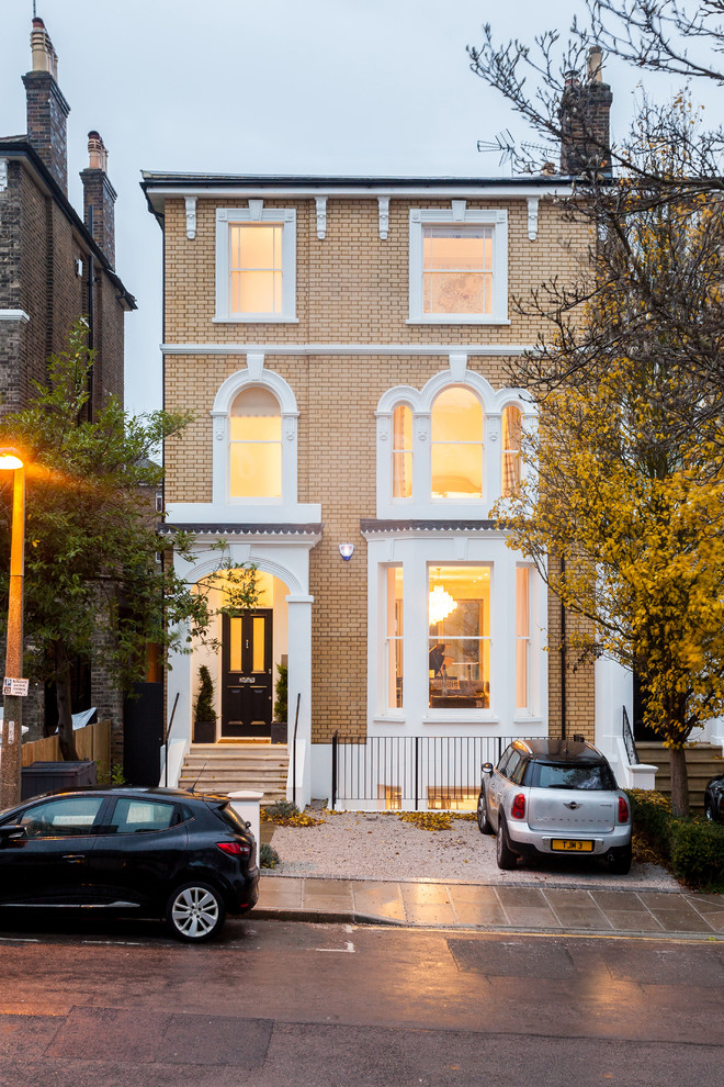 Photo of a medium sized traditional brick terraced house in London with three floors.