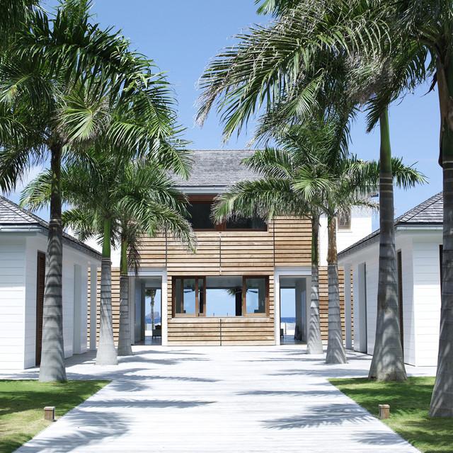 Beach house tropical exterior london by adam design for Beach house exterior design