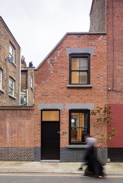 Urban two floor brick terraced house in London.