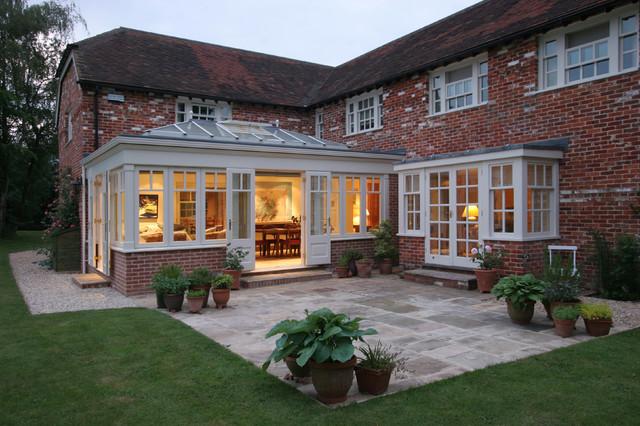 Red brick home orangery extension farmhouse exterior for Brick garden room designs