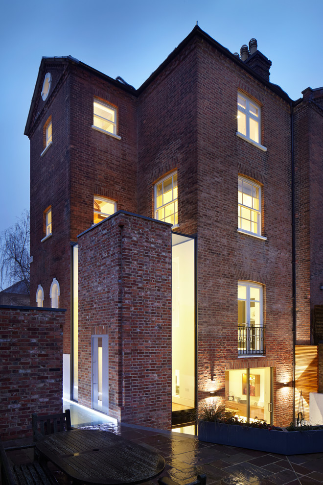 Photo of a red classic brick exterior in London with three or more floors.