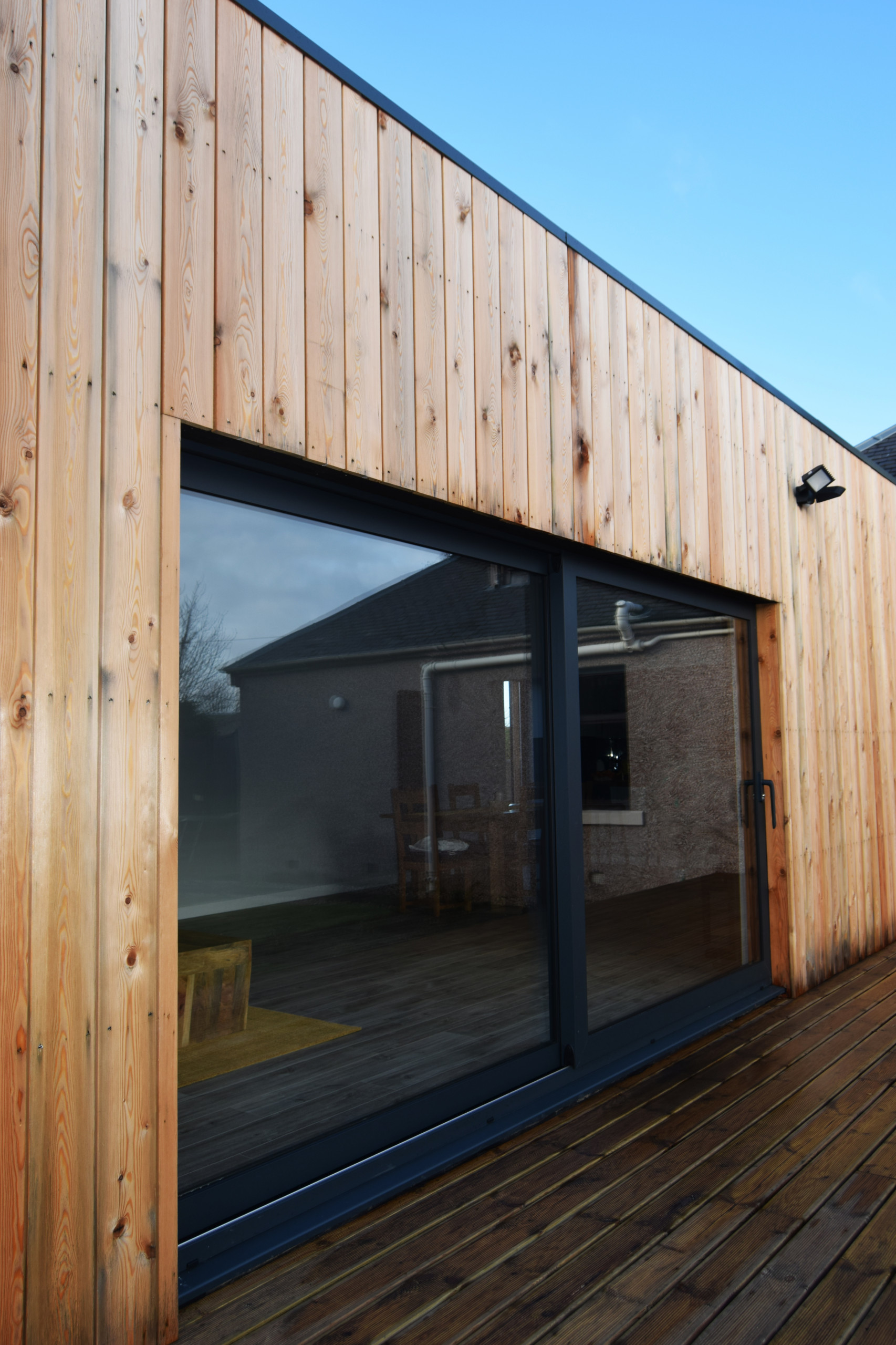 Timber Clad Extension to House