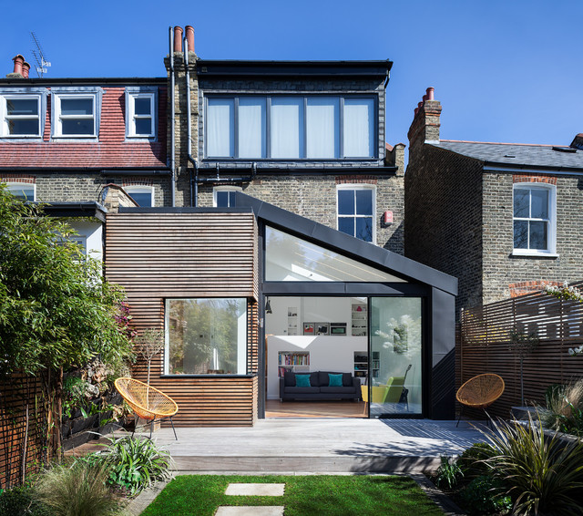 Inspiration for a contemporary two floor exterior in London with mixed cladding.