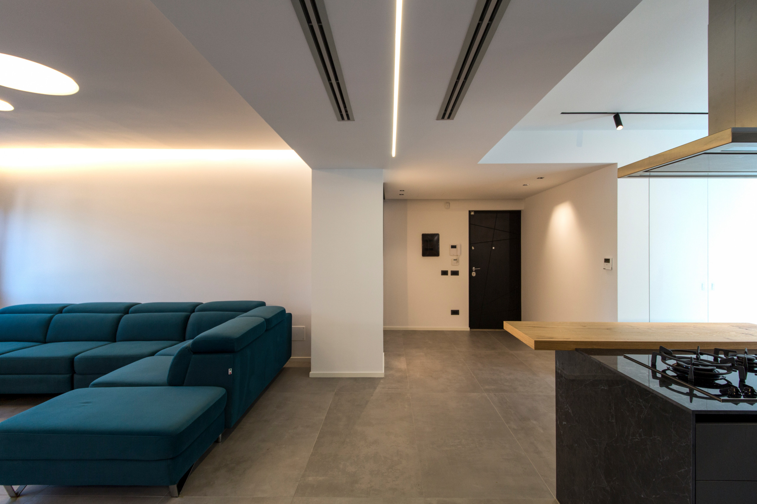 Inspiration for a large contemporary porcelain tile, gray floor and tray ceiling entryway remodel in Catania-Palermo with white walls and a black front door