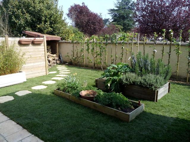 am nagement d 39 un jardin classique jardin paris par roots paysages. Black Bedroom Furniture Sets. Home Design Ideas