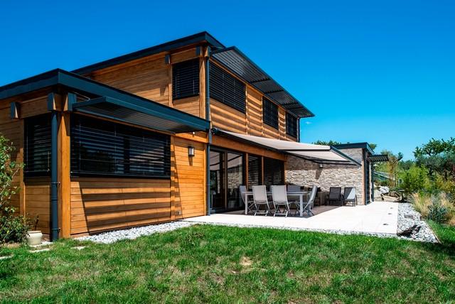 Maison bois poteau poutre toiture terrasse millery lyon 69 for Constructeur de maison en bois poteau poutre