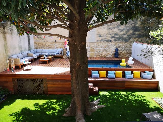 Un jardin avec piscine en ville - Modern - Garten ...
