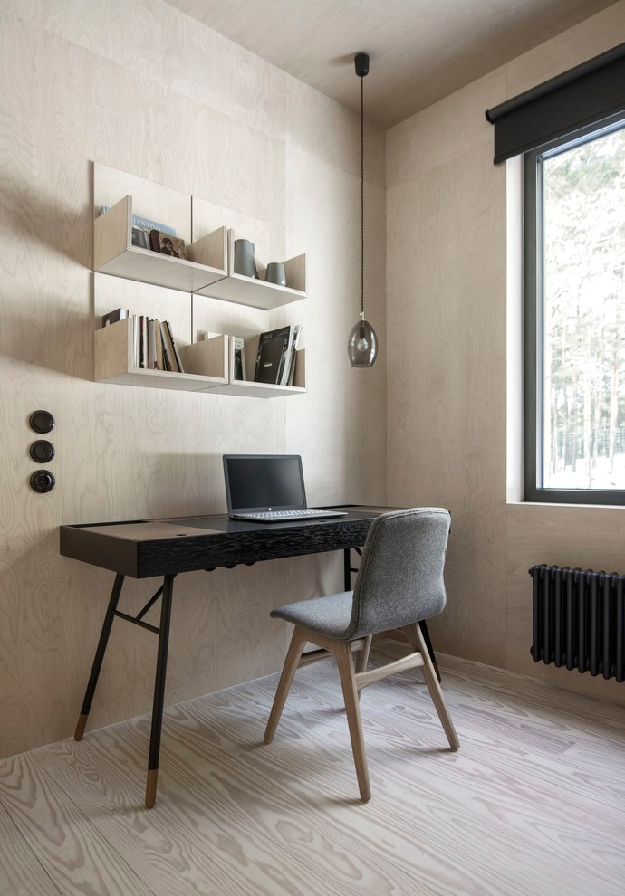 Inspiration for a small scandinavian freestanding desk light wood floor home office library remodel in Saint Petersburg with no fireplace