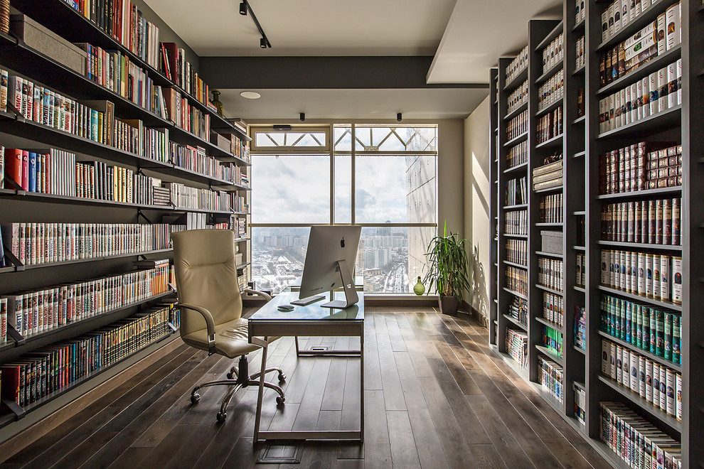 Home office library - contemporary freestanding desk dark wood floor and brown floor home office library idea in Moscow with no fireplace