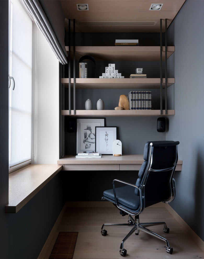 Inspiration for a large scandinavian built-in desk light wood floor and beige floor study room remodel in Moscow with gray walls