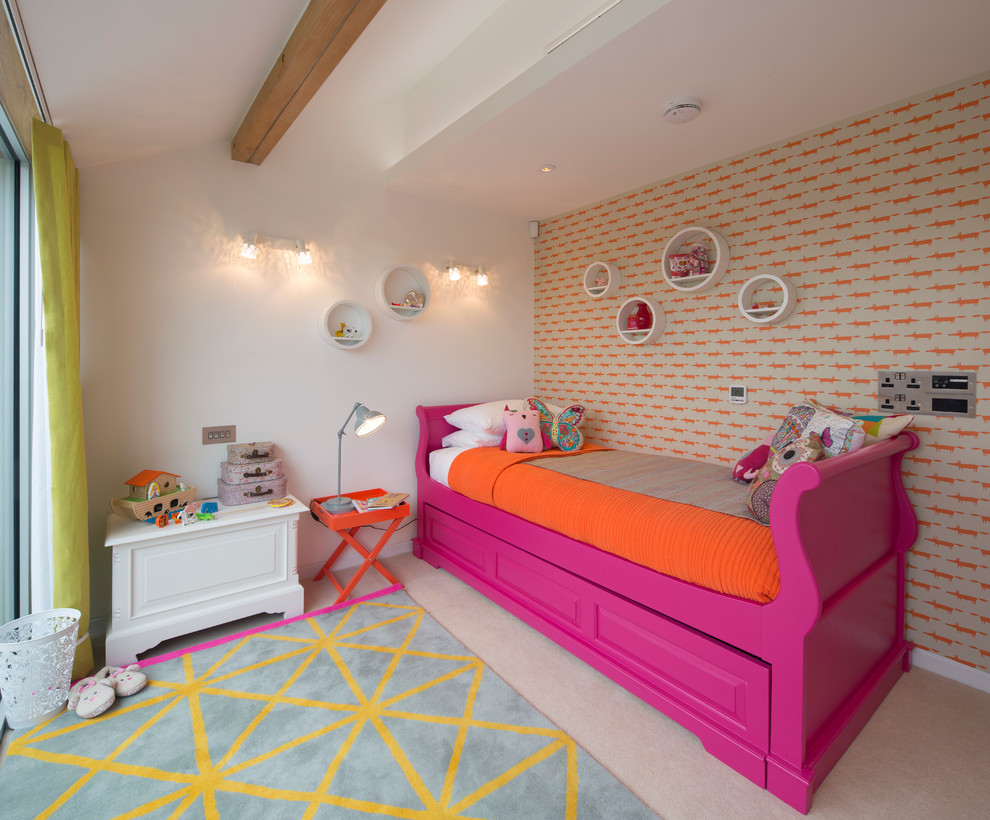 Inspiration for an eclectic girl carpeted kids' room remodel in London with multicolored walls