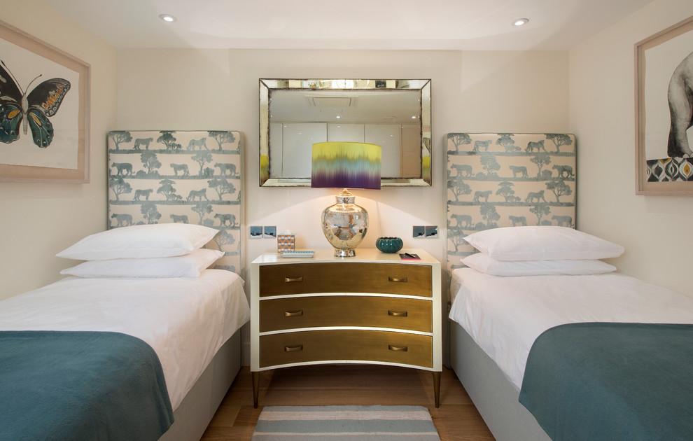 Kids' bedroom - transitional gender-neutral medium tone wood floor and brown floor kids' bedroom idea in London with beige walls