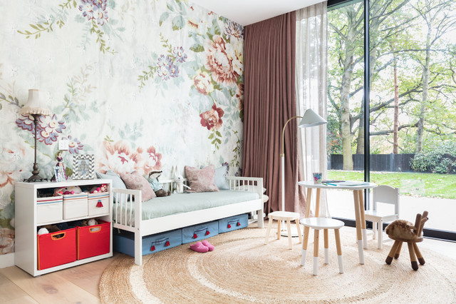 Inspiration for a scandinavian girl light wood floor kids' room remodel in London with multicolored walls