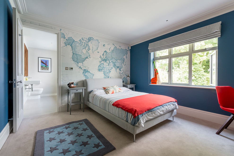 Inspiration for a mid-sized transitional boy carpeted and gray floor kids' room remodel in Surrey with blue walls