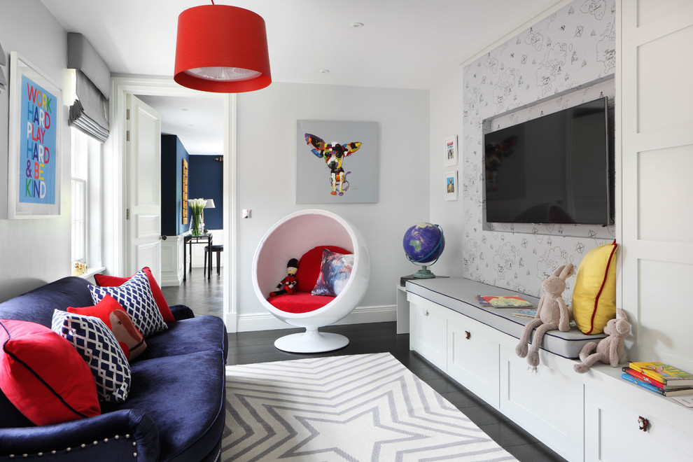Inspiration for a mid-sized transitional gender-neutral dark wood floor kids' room remodel in London with gray walls