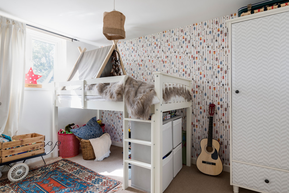 Mid-sized eclectic gender-neutral carpeted and beige floor kids' room photo in London with multicolored walls
