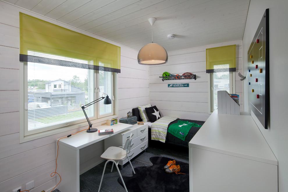Example of a danish boy dark wood floor kids' room design in Devon with white walls