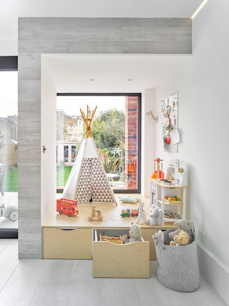 Inspiration for a scandinavian gender-neutral gray floor kids' room remodel in London with white walls