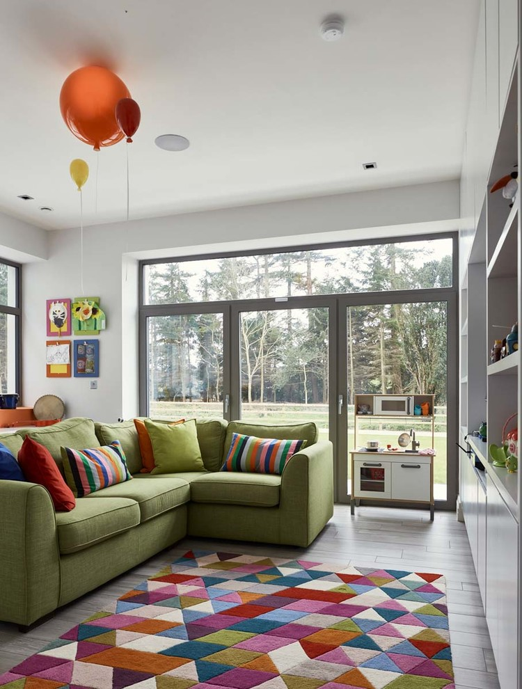 Inspiration for a contemporary gender-neutral gray floor kids' room remodel in Other with white walls