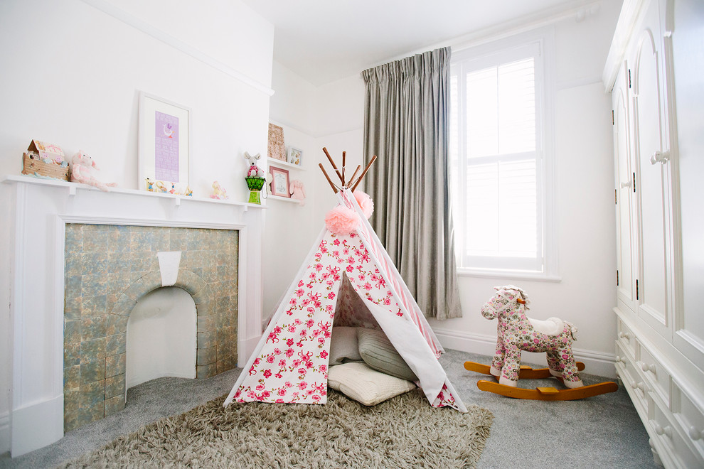 Cottage chic girl playroom photo in London