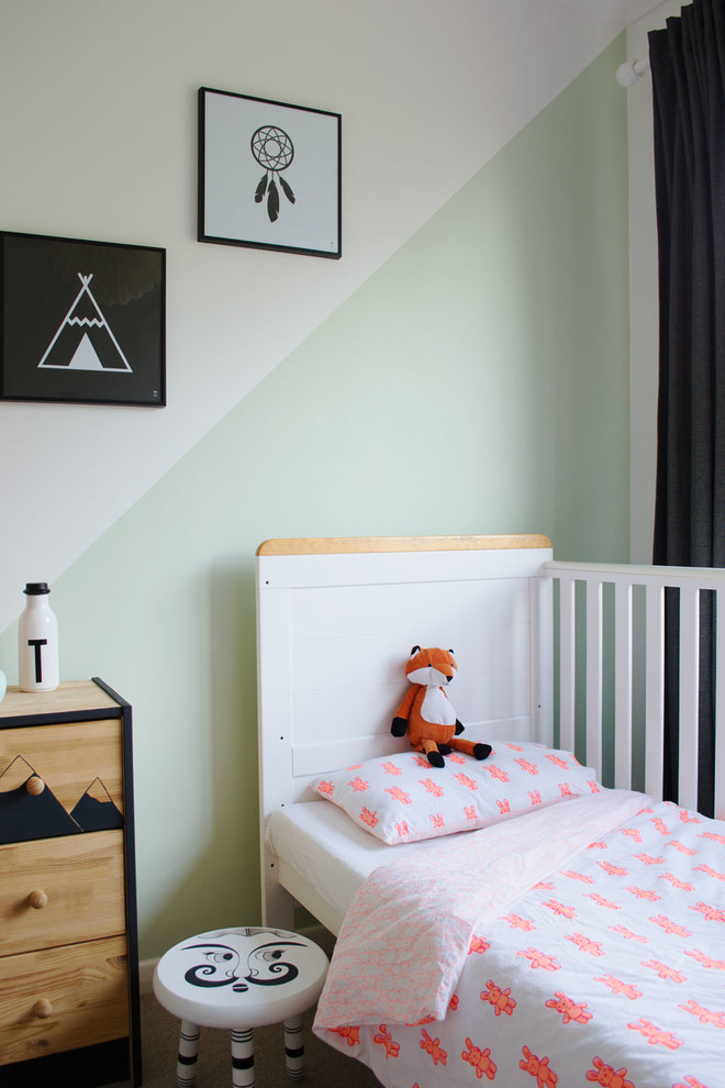 Kids' room - small scandinavian gender-neutral carpeted kids' room idea in Kent with white walls